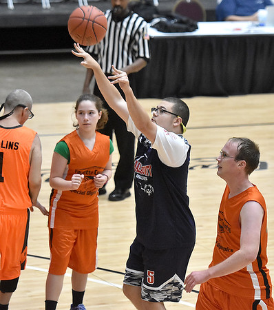 (Brad Davis/The Register-Herald) Raleigh County's Jakob Castle shoots against Fayette County during the Special Olympics game at the New River Community and Technical College Shootout Saturday morning at the Beckley-Raleigh County Convention Center.