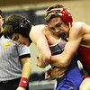 Greenbrier West's Clayton Robinson tries to get away from a hold by Hurricane's Tristan Scott during their 120-weight class during the West Virginia Army National Guard Duals in Summersville on Friday. (Chris Jackson/The Register-Herald)
