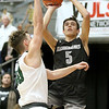 (Brad Davis/The Register-Herald) Westside's Ethan Blackburn shoots as Wyoming East's Jacob Bishop defends during the New River Community and Technical College Shootout Saturday at the Beckley-Raleigh County Convention Center.