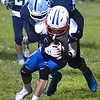Meadow Bridge's Cameron White brings down the Midland Trail ball carrier. Chad Foreman for the Register-Herald.