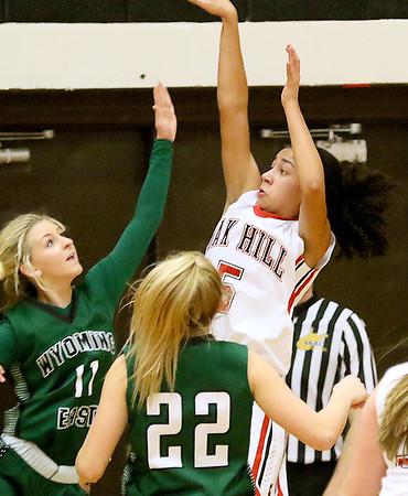 (Brad Davis/The Register-Herald) Oak Hill's Samiah Lynch drives and shoots as Wyoming East's Skylar Davidson defends Thursday night in Oak Hill.