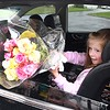 London Lostetter, 6, daughter of Scott and Jill Lostetter presents flowers for Charlee Roops first birthday held in Matt and Jenna Roops driveway off of Grandview Road in Beaver Saturday afternoon because of COVID-19. <br /> (Rick Barbero/The Register-Herald)