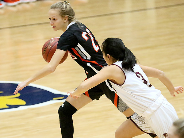 (Brad Davis/The Register-Herald) Summers County's Gavin Pivont drives up the court as George Washington's Vivian Ho defends during Big Atlantic Classic action Wednesday night at the Beckley-Raleigh County Convention Center.