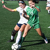 Isabella Cinco, of Charleston Catholic, right and Braylynn Travis, of Phillip Barbour, going after the ball during the semi-final match of the girls state soccer tournament held at Paul Cline Memorial Sports Complex in Beckley Friday morning.<br /> (Rick Barbero/The Register-Herald)