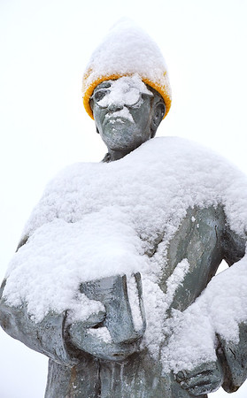 Alfred Beckley statue in Word Park on Neville Street, got covered up with snow early Tuesday morning.<br /> (Rick Barbero/The Register-Herald)