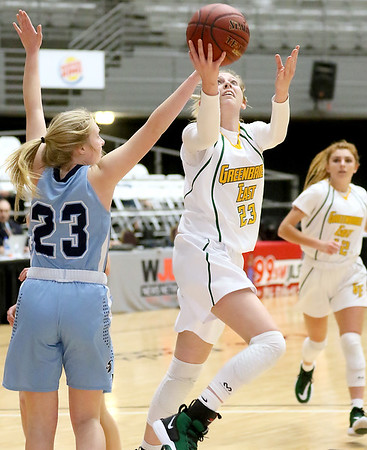 (Brad Davis/The Register-Herald) Greenbrier East's Haley McClure drives to the basket as Spring Valley's Sydney Meredith defends during Big Atlantic Classic action Thursday night at the Beckley-Raleigh County Convention Center.