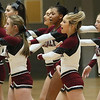 (Brad Davis/The Register-Herald) Woodrow Wilson cheerleaders perform during the first quarter break as they pull for their Flying Eagle classmates on the court against Hampshire during Big Atlantic Classic action Friday at the Beckley-Raleigh County Convention Center.