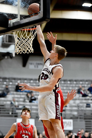 Woodrow Wilson's Ayden Ince (20)  puts up a layup during the first half of their basketball game in Beckley on Tuesday. (Chris Jackson/The Register-Herald)