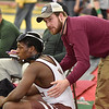 (Brad Davis/The Register-Herald) Woodrow Wilson wrestler Hezekyiah Creasy is consoled by assistant coach Logan Brown after losing his match to Morgantown's Preston Marman in the 160-pound weight class bracket Friday afternoon at the 73rd Annual State Wrestling Tournament in Huntington.