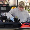 Jack Tolliver, of Beckley, uses precautions because of the coronavirus while pumping gas into a five gallon jug using a rubber glove at the Sheets Station on Neville Street in Beckley.<br /> (Rick Barbero/The Register-Herald)