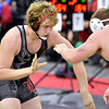(Brad Davis/The Register-Herald) Liberty's Jeff Bowles takes on Braxton County's Sturgis May in a 220-pound weight class matchup Friday night at the 73rd Annual State Wrestling Tournament in Huntington. Braxton County's May won the match.