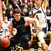 Wyoming East's Jacob Bishop (40) drives past Westside's Ethan Blackburn (5) during the first half of their basketball game in Clear Fork on Tuesday. (Chris Jackson/The Register-Herald)