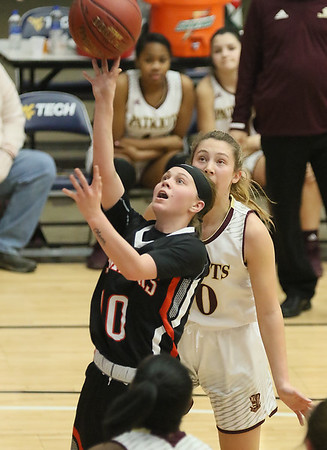 (Brad Davis/The Register-Herald) Summers County's Cheyenne Graham drives and scores around George Washington defender Mary Lyle Smith during Big Atlantic Classic action Wednesday night at the Beckley-Raleigh County Convention Center.