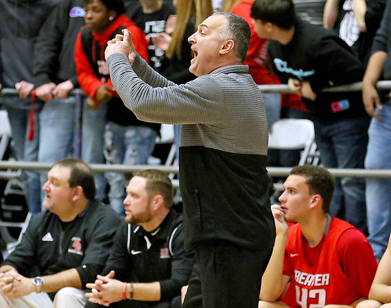 (Brad Davis/The Register-Herald) Greater Beckley head coach Brian Helton instructs his team Friday night at the Beckley-Raleigh County Convention Center.