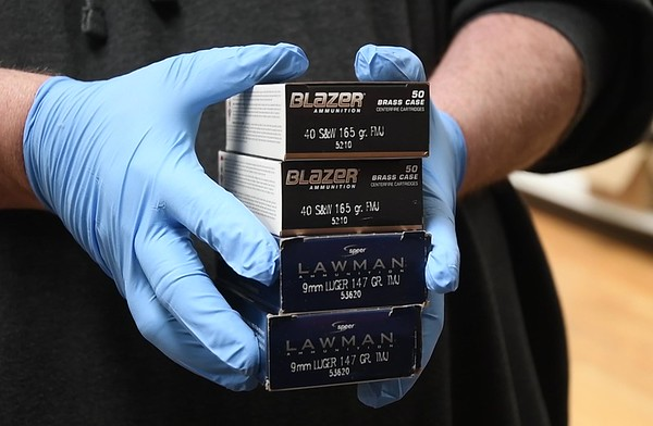 Customer at Flat Top Arms in Beckley stock up on ammo. Guns and ammo have been on the rise due to the coronavirus. <br /> (Rick Barbero/The Register-Herald)