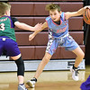 (Brad Davis/The Register-Herald) Court Kings' Keagan Davidson crosses over on a WV Villians defender during the Roundball Classic 5th Grade Championship Sunday morning at Woodrow Wilson High School. Court Kings won the game and took the title.
