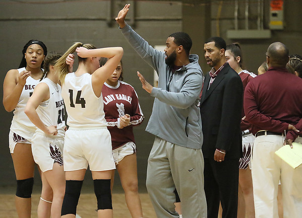 (Brad Davis/The Register-Herald) Woodrow Wilson assistant coach Gene Nabors and head coach Brian talk to their team during a timeout Thursday night.