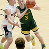 (Brad Davis/The Register-Herald) Greenbrier East's Clay Jackson works along the perimeter as University's Kaden Metheny defends during Big Atlantic Classic action Friday at the Beckley-Raleigh County Convention Center.