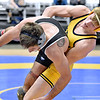 (Brad Davis/The Register-Herald) WVU Tech's Devin Wilhelm takes on St. Andrews' Noah Walker in a 149-pound weight class matchup during the Appalachian Athletic Conference Wrestling Tournament Saturday morning at the Beckley-Raleigh County Convention Center. Tech's Wilhelm won the match.
