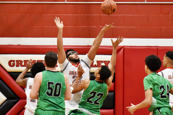 Greater Beckley Christian's (22) blocks a shot by Charleston Catholic Zion Suddeth (22) during the first half of their basketball game in Prosperity on Tuesday. (Chris Jackson/The Register-Herald)