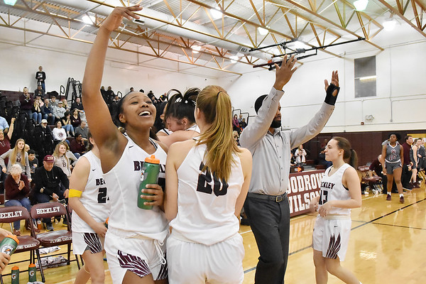 Members of the Woodrow WIlson Gilrs Basketball team, including senior Victoria Staunton, left, motion for studfents in the fan section following their Class AAA, Region Conference Final win over George Washington in Beckley on Tuesday. (Chris Jackson/The Register-Herald)