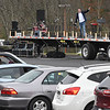 Pastor John Jordan of the Calvary Assembly of God church, preaches to his congregation from the church parking lot Sunday morning to celebrate the Easter holiday. Worshipers listened on the radio inside their vehicles due to the  COVID-19 pandemic. <br /> (Rick Barbero/The Register-Herald)