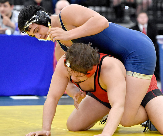 (Brad Davis/The Register-Herald) Nicholas County's Jacob Williams takes on Point Pleasant's Juan Marquez for the 195-pound championship Saturday night at the 73rd Annual State Wrestling Tournament in Huntington. Point Pleasant's Marquez won the match.