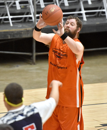 (Brad Davis/The Register-Herald) Fayette County's Thomas Nutter shoots against Raleigh County during the Special Olympics game at the New River Community and Technical College Shootout Saturday morning at the Beckley-Raleigh County Convention Center.