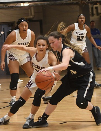 Woodrow Wilson girls vs Westside, during the second annual New River CTC Invitational held at the Beckley Raleigh County Convention Center. Woodrow won 60-35.<br /> (Rick Barbero/The Register-Herald)
