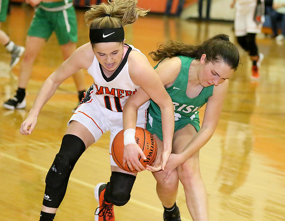 (Brad Davis/The Register-Herald) Charleston Catholic's Elizabeth Rushworth and Summers County's Taylor Isaac battle for a loose ball at mid-court Wednesday night in Hinton.