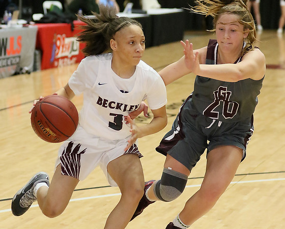 (Brad Davis/The Register-Herald) Woodrow Wilson's Keanti Thompson drives around George Washington's Mary Lyle Smith along the baseline during the final night of Big Atlantic Classic action Saturday at the Beckley-Raleigh County Convention Center.