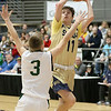 (Brad Davis/The Register-Herald) Shady Spring's Cole Chapman drives and scores as Greenbrier East's Clay Jackson defends during the New River Community and Technical College Shootout Saturday at the Beckley-Raleigh County Convention Center.