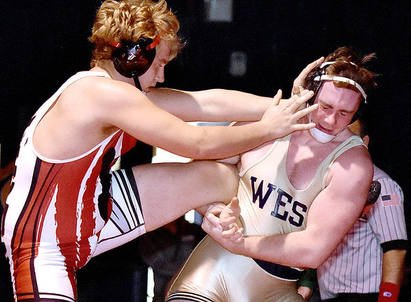 (Brad Davis/The Register-Herald) Liberty's Jeff Bowles takes on Greenbrier West's Noah Brown for the Class AA, Region 3, 220-pound weight class championship Saturday night in Coal City. West's Brown won the mach.