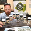 James Morgan, owner of Only Organics, with his display of Kratom in his store on 1320 South Eisenhower Drive in Beckley.<br /> (Rick Barbero/The Register-Herald)