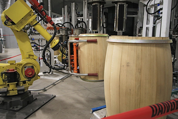 A machine moves barrels at the West Virginia Great Barrel Company Monday. The first truckload of 53-gallon whiskey barrels made their way from the company and were delivered to Smooth Ambler Spirits Monday. (Jenny Harnish/The Register-Herald)