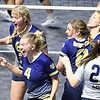Greenbrier West teams celebrates after winning the second set against Summers Co., during the quarter-final match of the Girls State Volleyball Tournament held at the Charleston Civic Center Wednesday morning. Summer Co. won the match 3 sets to 1<br /> (Rick Barbero/The Register-Herald)