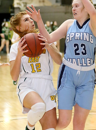 (Brad Davis/The Register-Herald) Greenbrier East's Emma Dotson drives to the basket as Spring Valley's Sydney Meredith defends during Big Atlantic Classic action Thursday night at the Beckley-Raleigh County Convention Center.