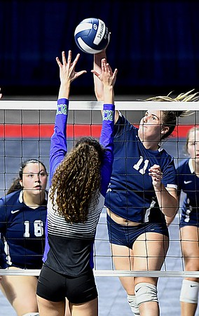 Ashley Farruggia, of Shady Spring, spikes the ball over Robert C Byrd defender in the semi-final match of the Girl Calss AA State Volleyball Tournament held at the Charleston Civic Center Friday afternoon. Shady won the match 3-1<br /> (Rick Barbero/The Register-Herald)