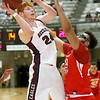 (Brad Davis/The Register-Herald) Woodrow Wilson's Ben Gilliam drives to the basket as Greater Beckley's Isaiah Hairston defends Friday night at the Beckley-Raleigh County Convention Center.