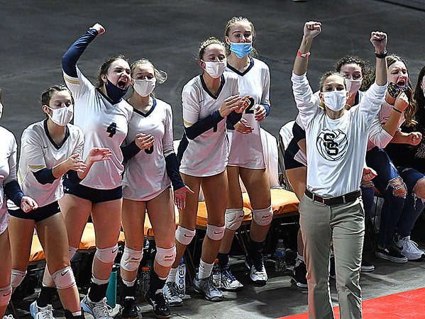 Shady Spring head coach Kelly Williams, celebrates after winning the second set against Phillips Barbour in the Class AA championship match of the girls volleyball tournament in Charleston Friday even held at the Charleston Civic Center. Shady won the Championship 3-0<br /> (Rick Barbero/The Register-Herald)