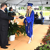 Greenbrier County School superintendent,  Jeff Bryant, hands Emma Osbourne, class president her diploma during Greenbrier West High School graduation ceremony Friday evening held at the State Fair of West Virginia's free parking lot in Fairlea. <br /> (Rick Barbero/The Register-Herald)