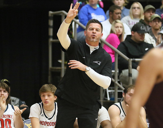 (Brad Davis/The Register-Herald) Independence head coach Mike Green instructs his team against Pocahontas County during Friday action at the New River Community and Technical College Shootout at the Beckley-Raleigh County Convention Center.
