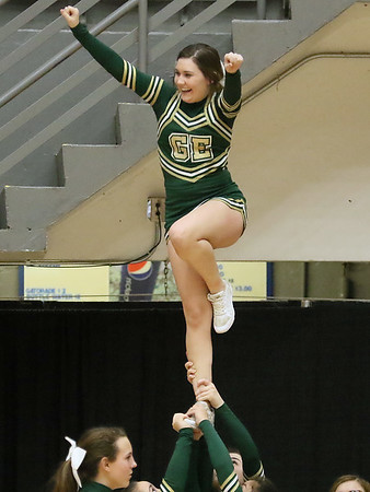 (Brad Davis/The Register-Herald) Greenbrier East cheerleaders perform during Big Atlantic Classic action Thursday night at the Beckley-Raleigh County Convention Center.