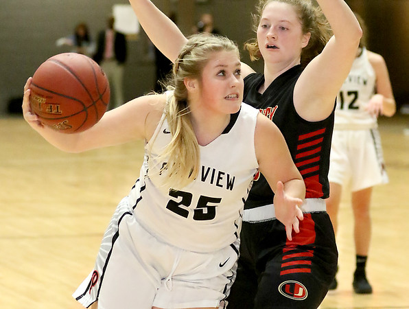 (Brad Davis/The Register-Herald) PikeView's Anyah Brown drives to the basket as University's Mallory Napolillo defends during Big Atlantic Classic action Thursday night at the Beckley-Raleigh County Convention Center.
