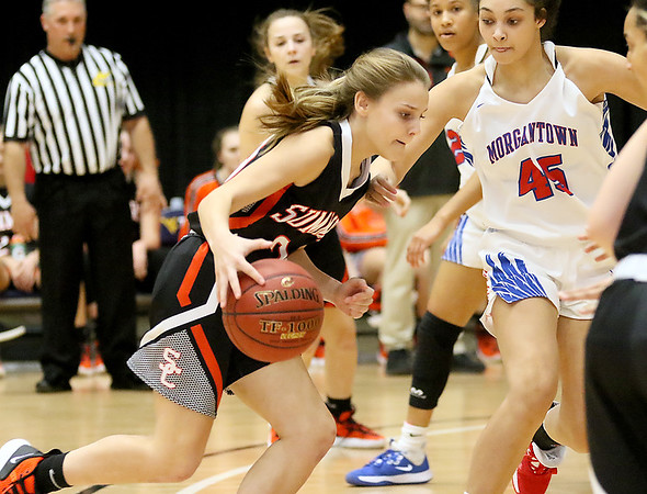 (Brad Davis/The Register-Herald) Summers County's Liv Meador moves along the perimeter as Morgantown's Revaya Sweeney defends during the final day of Big Atlantic Classic action Saturday at the Beckley-Raleigh County Convention Center.
