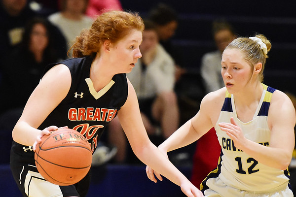 Greater Beckley Christian's (00) looks to get past Greenbrier West's (12) during their basketball game in Charmco on Thursday. (Chris Jackson/The Register-Herald)