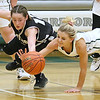 (Brad Davis/The Register-Herald) Westside's Makayla Morgan and Wyoming East's Skylar Davidson dive for a loose ball Wednesday night in New Richmond.