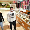 Olivia Ziolkowski, of Beckley, left and Luke Mann, of Daniels, both students at Woodrow Wilson High School, walk the Mall together. The mall opened Thursday at 11 am. for the first time in two monthes because of COVID-19. <br /> (Rick Barbero/The Register-Herald)