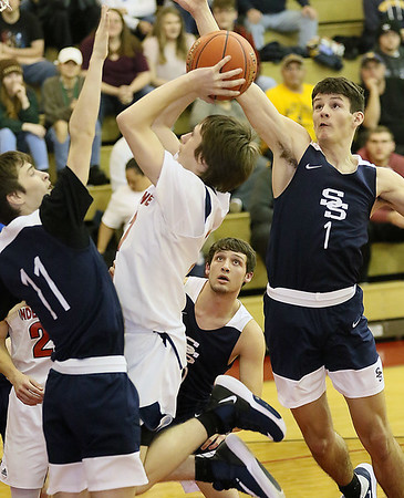 (Brad Davis/The Register-Herald) Shady Spring defenders Cole Chapman (#11) and Greyson Shepherd (#1) converge on Independence's Cyrus Goodson as he drives to the basket Friday night in Coal City.