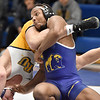 (Brad Davis/The Register-Herald) WVU Tech's Leslie Campbell takes on Reinhardt's Cole Tenety in a 174-pound weight class matchup Friday night inside Tech's Van Meter Gym. Reinhardt's Tenety won the match.